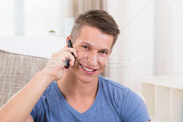 Férfi beszél mobiltelefon portré fiatal boldog Stock fotó © AndreyPopov