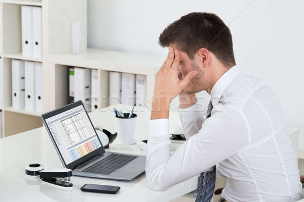Businessman Suffering From Headache At Desk Stock photo © AndreyPopov