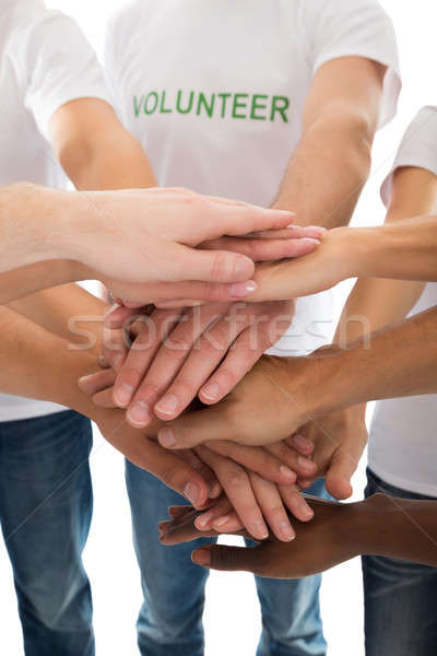 Midsection Of Multiethnic Volunteers Piling Hands Stock photo © AndreyPopov