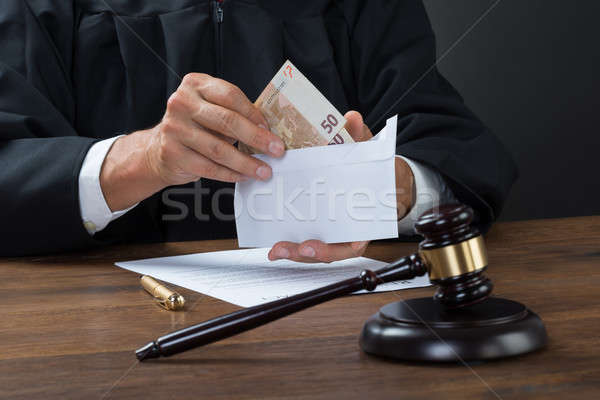 Judge Removing Money From Envelope Stock photo © AndreyPopov