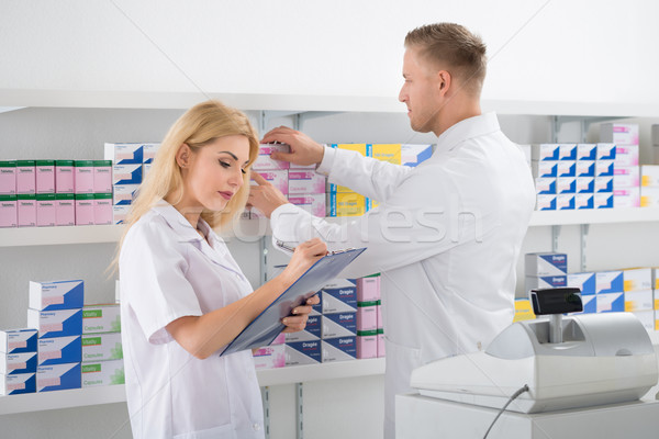 Pharmacists Checking Inventory At Pharmacy Stock photo © AndreyPopov