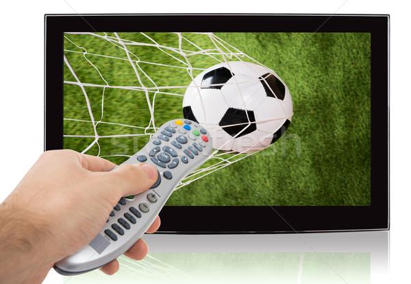 Foto stock: Mão · controle · remoto · ver · futebol · televisão · tela · plana