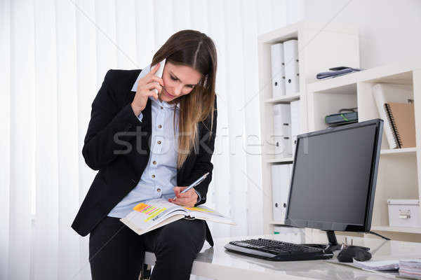 Businesswoman Writing Schedule In Diary Stock photo © AndreyPopov