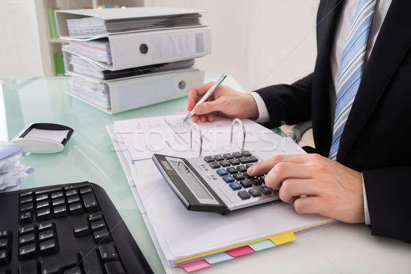 Biznesmen rachunek Kalkulator człowiek wykonawczej Zdjęcia stock © AndreyPopov