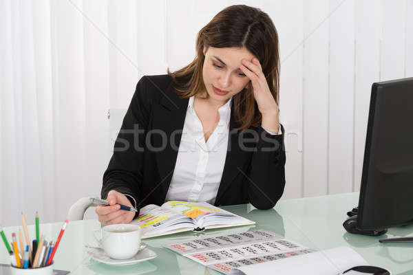 Tired Businesswoman Writing Schedule In Diary Stock photo © AndreyPopov