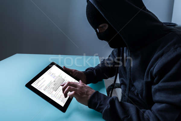 Hacker Stealing Information From Digital Tablet Stock photo © AndreyPopov