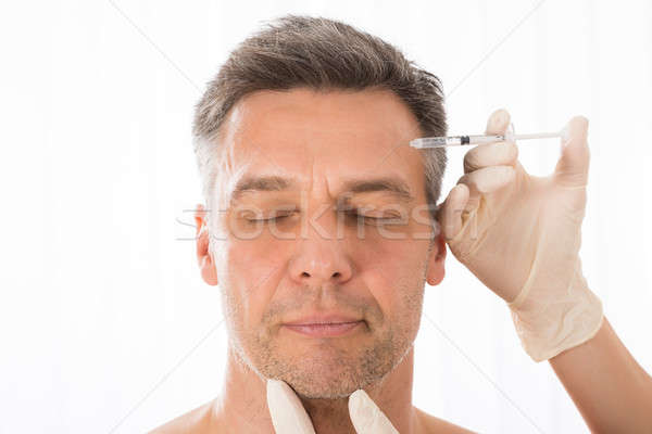 Mature Man Get Injection On His Face Stock photo © AndreyPopov