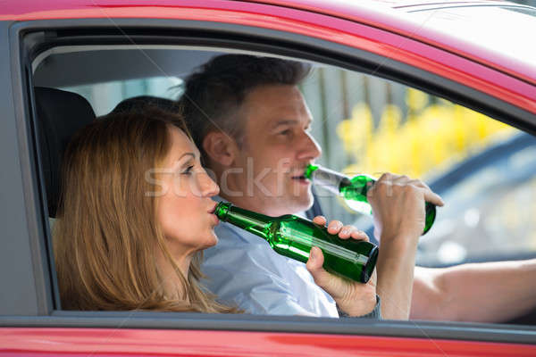 Couple Drinking Alcohol In Car Stock photo © AndreyPopov