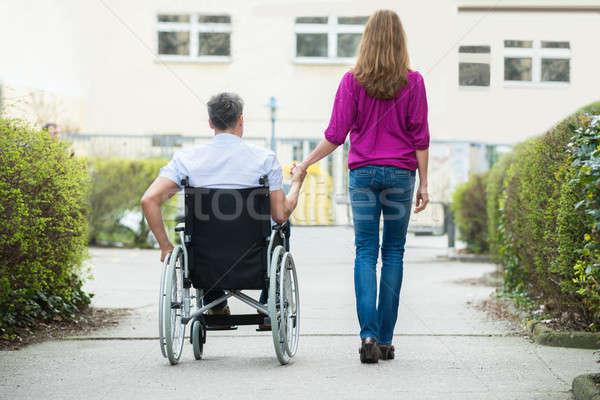 Kobieta niepełnosprawnych mąż widok z tyłu wózek ulicy Zdjęcia stock © AndreyPopov
