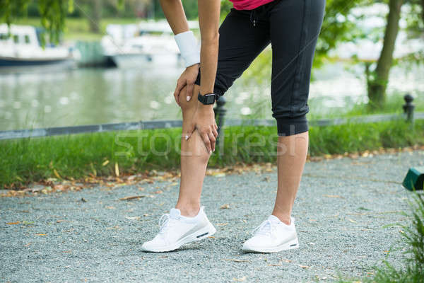 Female Jogger Having Pain In Her Knee Stock photo © AndreyPopov