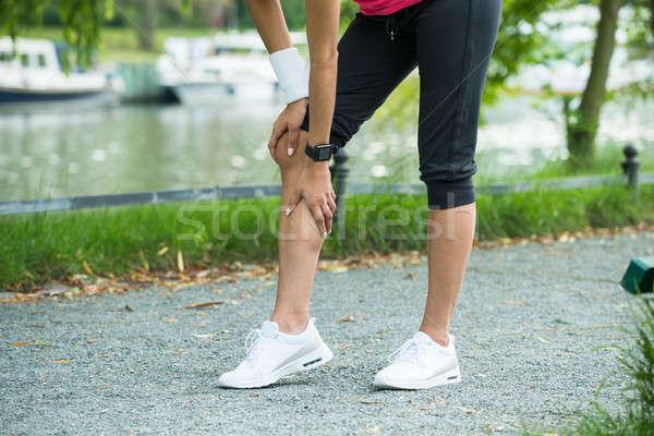 Kadın jogging yapan ağrı diz spor Stok fotoğraf © AndreyPopov