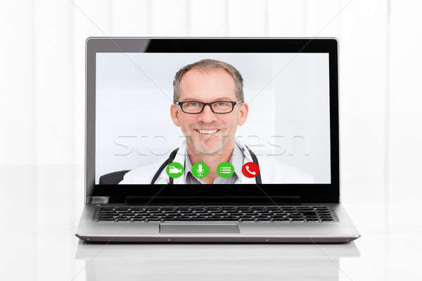 Videoconferencing With Doctor On Laptop Stock photo © AndreyPopov