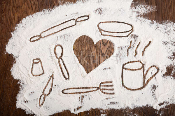 Kitchen Utensil Drawn On Flour Stock photo © AndreyPopov