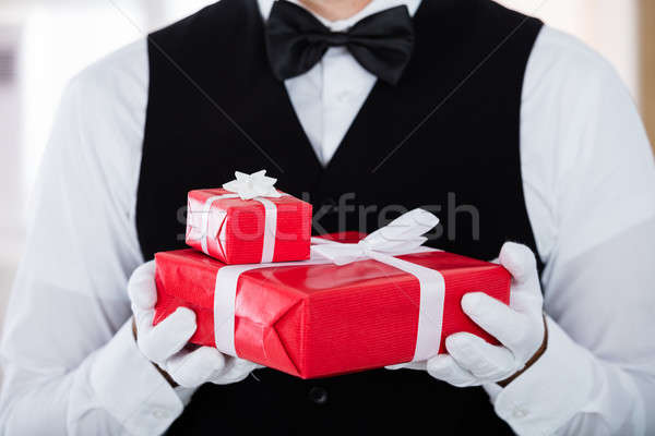 Garçon blanche gants cadeau Photo stock © AndreyPopov