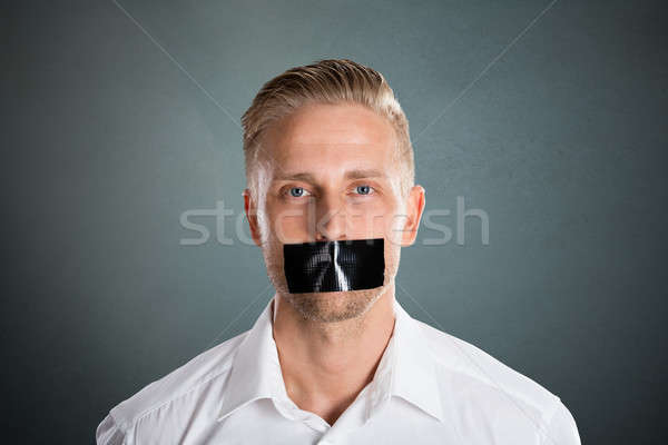 Man With Black Duct Tape Over His Mouth Stock photo © AndreyPopov