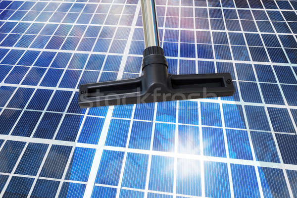 Cleansing Tool On Solar Panel Stock photo © AndreyPopov
