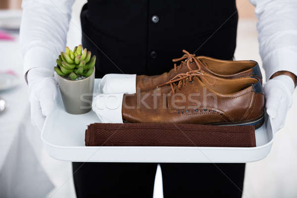 Butler Carrying Pair Of Brown Shoes Stock photo © AndreyPopov