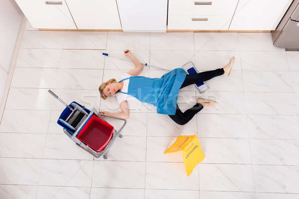 Fainted Housemaid Lying On Floor In Kitchen Stock photo © AndreyPopov