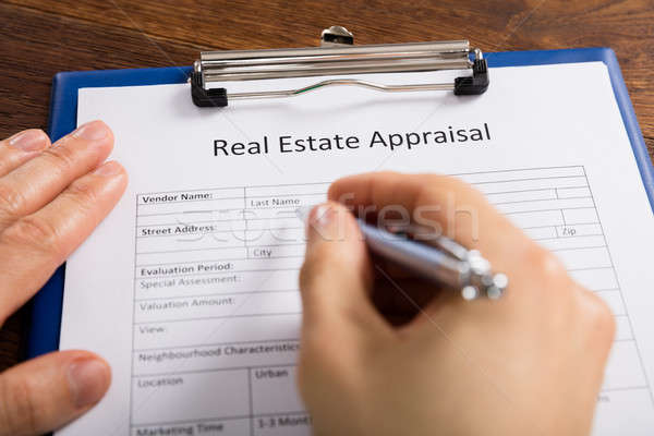 Person Hand Filling Real Estate Appraisal Form Stock photo © AndreyPopov
