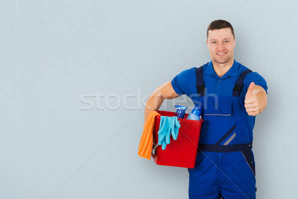 Male Janitor Carrying Cleaning Equipment Stock photo © AndreyPopov