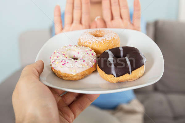 Woman Rejecting Doughnuts Stock photo © AndreyPopov