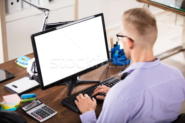 Stock photo: Businessman Using Blank Computer