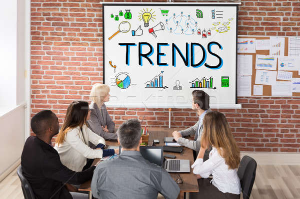 Businesspeople Looking At Trends Presentation Stock photo © AndreyPopov
