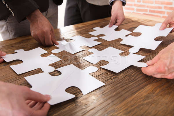 Businesspeople Arranging The Puzzle Stock photo © AndreyPopov