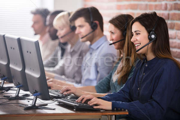 Female Customer Services Agent In Call Center Stock photo © AndreyPopov