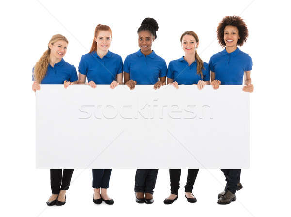Group Of Female Janitors Holding Billboard Stock photo © AndreyPopov