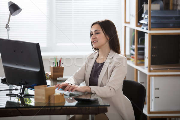 Business Woman Working In Office Stock photo © AndreyPopov