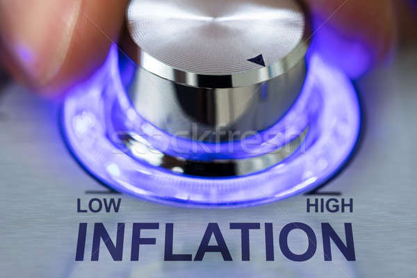 Hand Turning Illuminated Knob By Inflation Text Stock photo © AndreyPopov