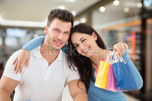 Couple With Small Multi Colored Shopping Bags Stock photo © AndreyPopov