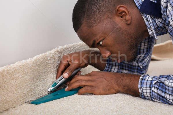 Rzemieślnik dywan piętrze domu człowiek Zdjęcia stock © AndreyPopov