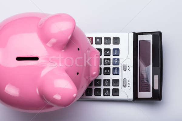 Elevated View Of Piggy Bank And Calculator Stock photo © AndreyPopov