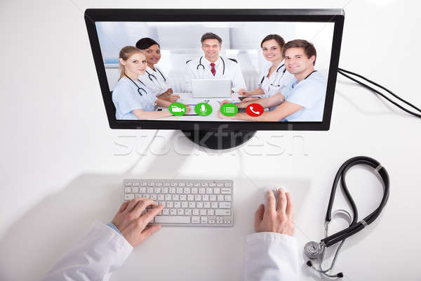 Doctor Video Conferencing With Medical Team On Computer Stock photo © AndreyPopov