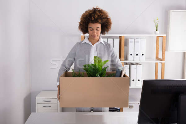 Businesswoman Carrying Cardboard Box With Her Belongings Stock photo © AndreyPopov