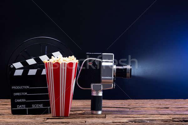 Film kamera pattogatott kukorica tábla megvilágított kék étel Stock fotó © AndreyPopov