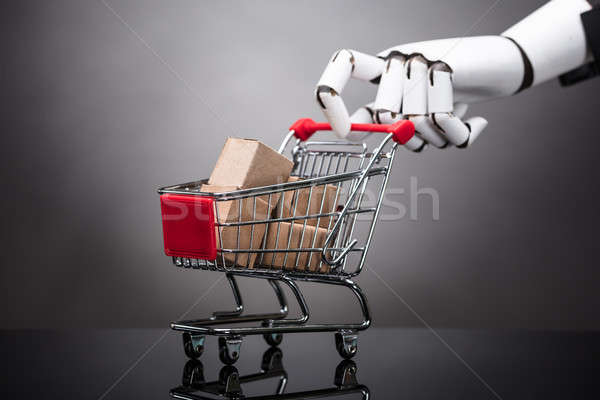 Robot Holding Shopping Cart With Cardboard Boxes Stock photo © AndreyPopov