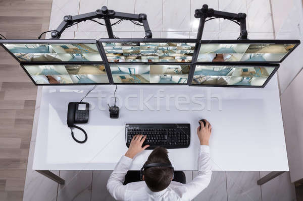 Security Guard Monitoring Multiple Camera Footage On Computer Stock photo © AndreyPopov