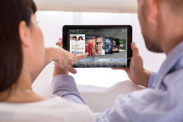 Foto stock: Casal · escolher · on-line · filmes · digital · comprimido