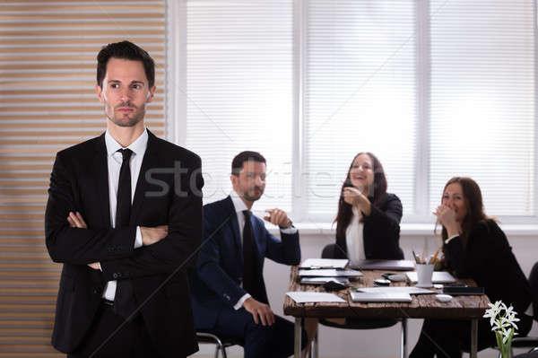 Ritratto infelice imprenditore colleghi ridere ufficio Foto d'archivio © AndreyPopov