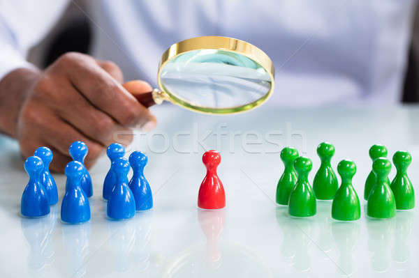 Male Looking At Colorful Pawns With Magnifying Glass Stock photo © AndreyPopov