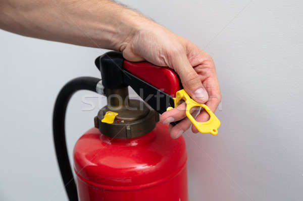 Technician Inspecting Hose Of The Fire Extinguisher Stock photo © AndreyPopov