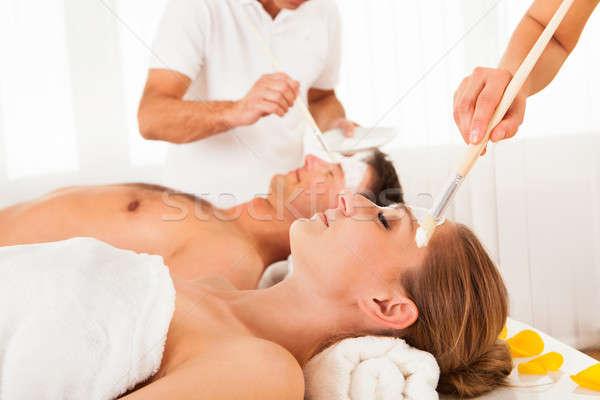 Beautician applying a face mask Stock photo © AndreyPopov