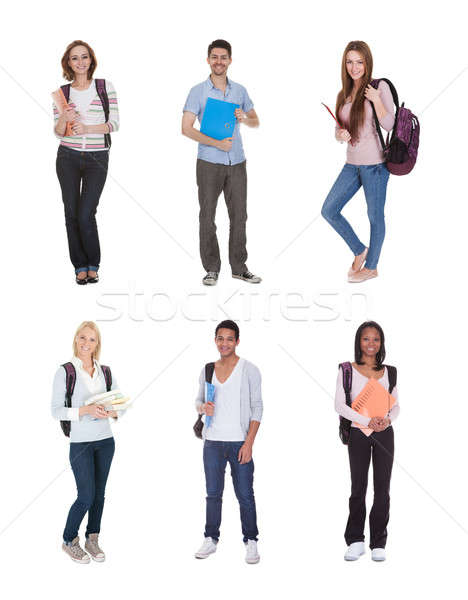 Racial grupo estudantes jovem em pé branco Foto stock © AndreyPopov