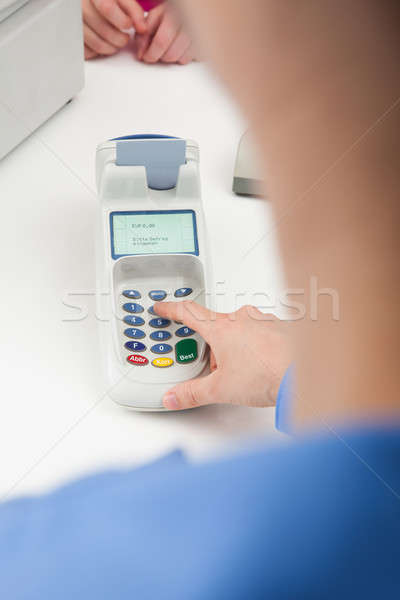 Finger Entering The Pin Code In Card Reader Machine Stock photo © AndreyPopov