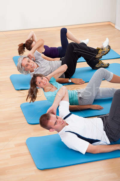 Group of people exercising in a gym class Stock photo © AndreyPopov