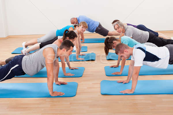 Gym class doing press ups Stock photo © AndreyPopov