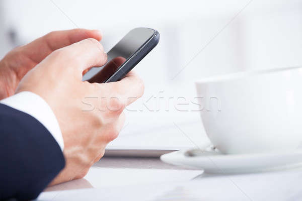 Close-up Of Businessman Using Cell Phone While Stock photo © AndreyPopov